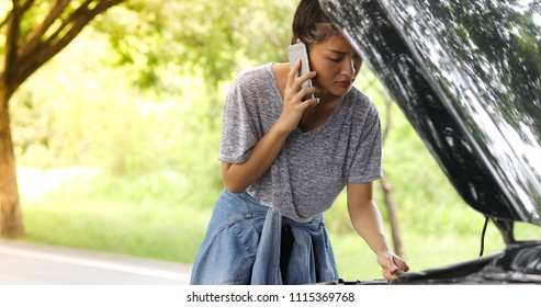 Blurry and soft focus of Asian woman using mobile phone while looking and Stressed man sitting after a car breakdown on street