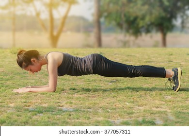 Blurry and soft focus of Athletic woman asian warming up and Young female athlete sitting on an exercising and stretching in a park before Runner outdoors, healthy lifestyle concept