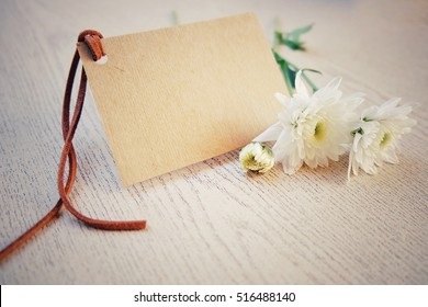 Blurry and soft focus. White flowers and a card with space for text. retro and vintage tone. hipster tone style.