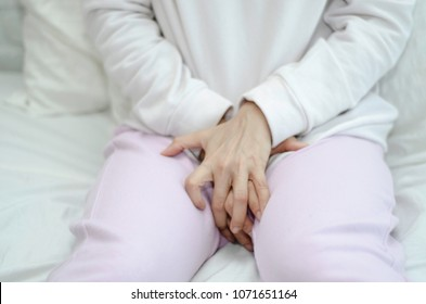 Blurry too soft Woman wearing pink pants the itching on vaginal. Genital itching caused by fungus in underwear.