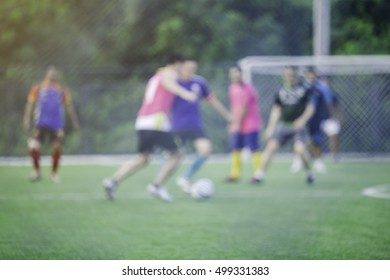 Blurry sport background of football soccer match. Training and game for men.