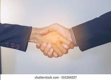 Blurry Successful businessman giving a hand to shake.Business People Teamwork Collaboration Relation Concept.Split tone instagram like.With hot light Processed.