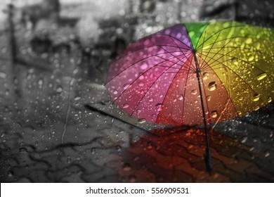 Blurry of umbrella ,view through the window on rainy day.