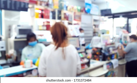 blurry view of people wearing medical mask while working  and shopping in convenience store during covid-19 or coronavirus situation. new normal for lifestyle during epidemic of virus time.