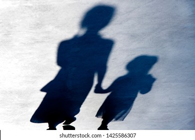 Blurry vintage shadows silhouettes of two female person walking  in black and white night