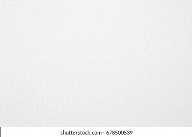 Blurry white paper background.