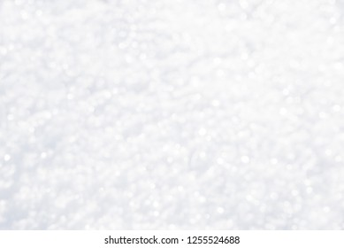 blurry white snowflakes background defocused
