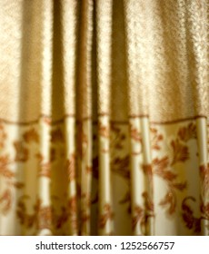 Blurry yellowish curtain clothes unique photo