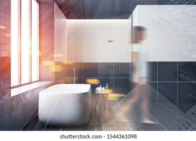 Blurry young woman walking in modern bathroom with black and white tiled walls, comfortable white bathtub and shower stall in background. Toned image double exposure