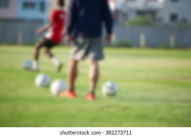 blurry,motion blur,Calf Muscle of Players in action playing football (soccer)