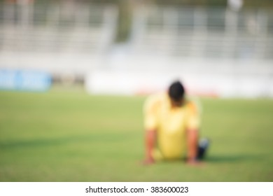 blurry,motion blur,Coach fitness in action playing football,Stretching (soccer)