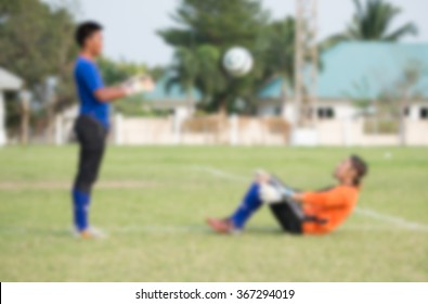 blurry,motion blur,Goalkeeper in action playing football,(soccer)