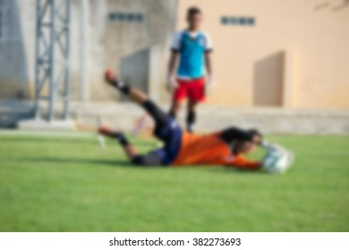 blurry,motion blur,Goalkeeper in action playing football(soccer)