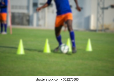 blurry,motion blur,Players in action playing football (soccer)