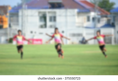 blurry,motion blur,Players in action playing football,happy  (soccer)