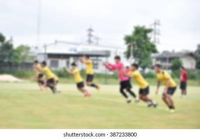 blurry,motion blur,Players in action playing football,jumping (soccer)