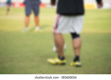 blurry,motion blur,Players in action playing football,Passing (soccer)