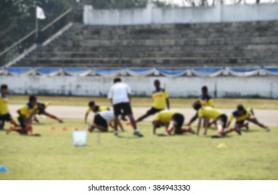 blurry,motion blur,Players in action playing football,Stretching (soccer)