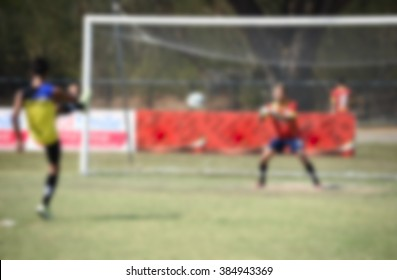 blurry,motion blur,Players in action playing football,warm(soccer)
