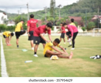 blurry,motion blur.players playing football,Stretching(soccer)