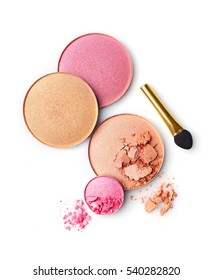 Blush or face powder and pink eyeshadow with applicator isolated on white background