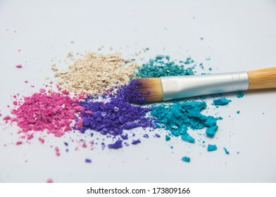 blush and multicolor crushed eye shadows on white background