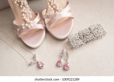 Blush pink bridal shoes and accenting jewelry, 2017