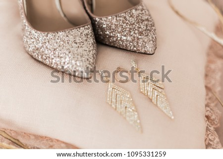 5197efa4040f Blush pink bridal shoes and accenting jewelry with gold floral decoration.  Pink background. Close
