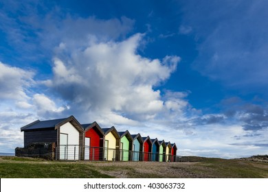 BLYTH. NORTHUMBERLAND. ENGLAND. UK. MARCH 28. 2016. Brightly painted beach huts at South Beach, Blyth. March 28.2016. Blyth, Northumberland, England, UK.