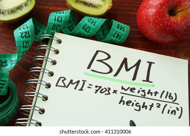 BMI body mass index (English or imperial formula) written on a notepad sheet.