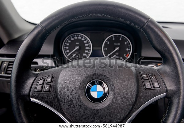 BMW logo on steer wheel. 320 model. MOSCOW, RUSSIA - FEBRUARY 17, 2017: Parked the car near the city open by owner and specially prepared for taking pictures.