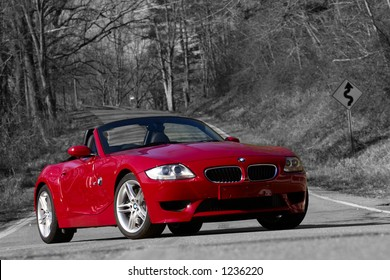 BMW M Z4 on the road, colour isolation on black and white