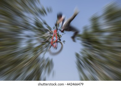 bmx bicycle rider tricking in the air ,acrobatic stunts with bicycle