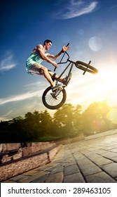 bmx bicycle rider tricking on the highlights