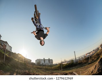 BMX Bike back flip jump on a dirt track.