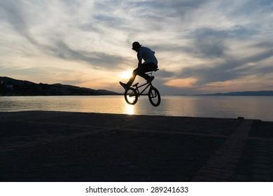 Bmx biker silhouette.