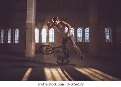 Bmx freestyle. A man on bmx doing tricks.
