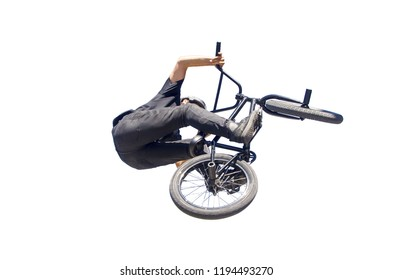 bmx rider in black performing a jump with his bycicle isolated over white