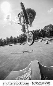 A BMX rider doing a stunt at the skatepark
