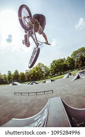 A BMX rider doing a stunt at the skatepark