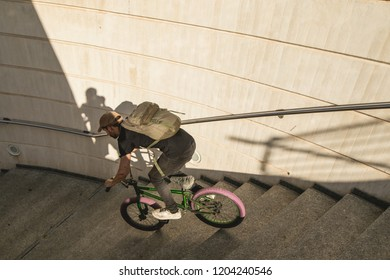 BMX rider down a city street. Freestyle Bmx