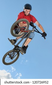 Bmx rider making a bike jump called table top