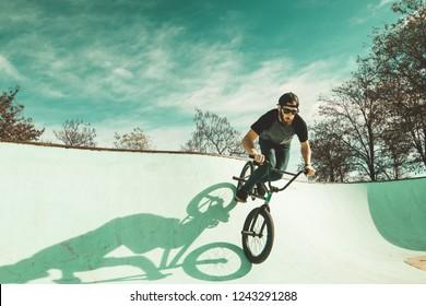 BMX rider making tricks.Guy riding a bmx bike and jumping