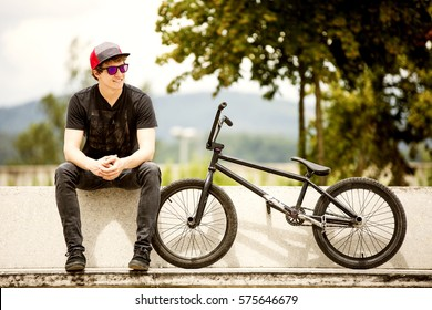 BMX rider sitting on bench