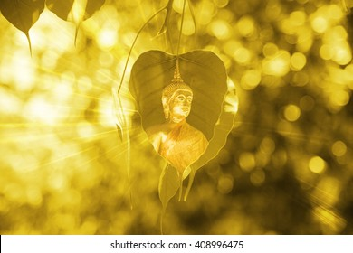 Bo leaves gold with buddha image, Golden Leaf, Bodhi Tree with sun bright, power of buddha background concept.