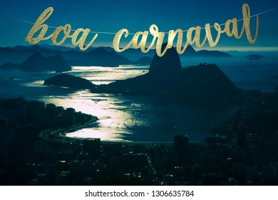 Boa Carnaval (Happy Carnival in Portuguese) gold glitter banner hanging above a moonlit Rio de Janeiro skyline with Sugarloaf Mountain at night