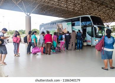 BOA VISTA, BRAZIL - AUGUST 12, 2015: People entering the bus to Caracas (Venezuela) at bus terminal in Boa vista city.