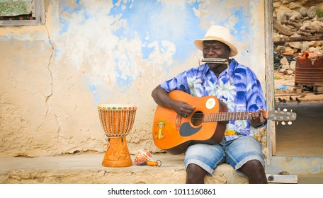 Boa Vista, Cape Verde - December 20, 2017: View of local people performing traditional music on the streets of Rabil on the island of Boa Vista, Cape Verde, Africa