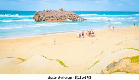 Boa Vista, Cape Verde - December 20, 2017: Tourists visit the shipwreck of Cabo Santa Maria on the island of Boa Vista, Cape Verde, Africa