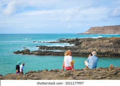 Boa Vista, Cape Verde - December 20, 2017: Tourists visit the volcanic beach on the island of Boa Vista, Cape Verde, Africa
